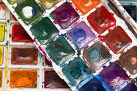 Closeup of messy, used water-color paint-box, water-color