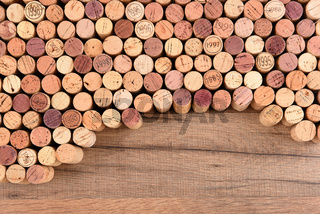 High angle shot of a group of wine corks on wood table with copy space