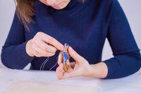 Designer making handmade brooch