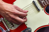 Hand and fingers playing eletric guitar