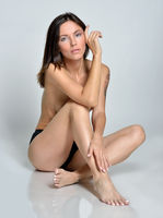 barefoot woman only in panties sitting on the floor