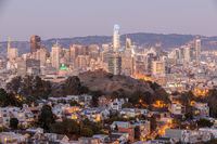 Dusk over San Francisco Downtown with Columbus Day Lights.