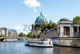 Tour boat cruising by Spree river in Berlin