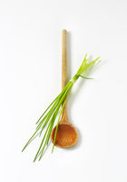 Chives and a wooden spoon
