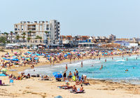 Crowd of people on the beach of La Mata at summer. Costa Blanca. Spain