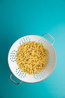 Uncooked gemelli pasta.