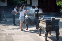 People praying in Wenshu buddhist monastery in Chengdu, China