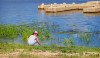 Girl at the water on the river Bank.