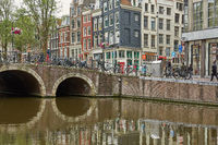 One of the many bridges over a canal in Amsterdam Netherlands