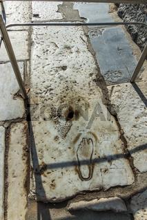 A footprint craved on marble floor at Ephesus