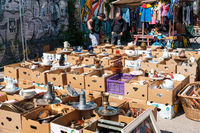 Boxes with second hand objects on flea market in Berlin