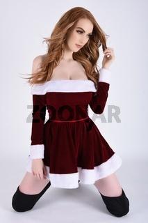 Vollbusige Rothaarige, Sexy Santa, zeigt ihre Bruste