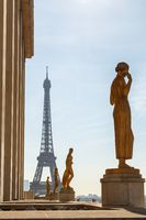 Paris, France, March 27 2017: Row of golden statues, Place du Trocadero in city Paris,on a summer morning, in front of the Eiffel tower