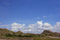 View of the rock mountains and clouds at Hampi, Karnataka, India.