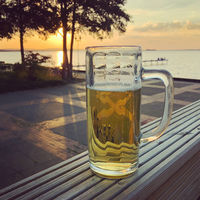 beer glass with sunset