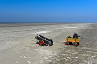 Handcart in the wadden sea at low tide,  Westerhever, Schleswig-Holstein, Germany