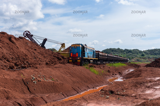 Excavator loading clay to the train