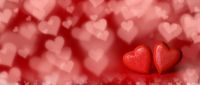 Red hearts on bokeh background
