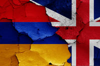flags of Armenia and UK painted on cracked wall