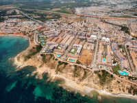 Aerial photography drone point of view turquoise bay of Mediterranean Sea waters and coastline Cabo Roig Torrevieja from above at summer, Province of Alicante, Costa Blanca, Spain