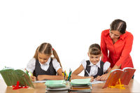 The teacher goes around the students, looks in the notebook, the students solve the task