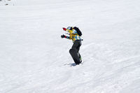 Snowboarder jump on snowy ski slope at high winter mountains