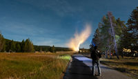 Eruption of Old Faithful geyser at Yellowstone National Park at night
