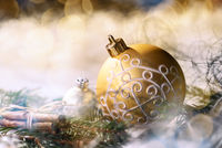 Golden bauble and christmas decoration
