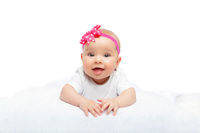 happy beautiful baby girl with pink flower on head