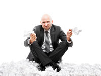 Angry businessman in depression hand holding crumpled torn paper document