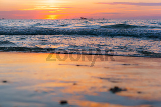 beautiful sunrise and waves on the sea, sunset on the Baltic sea
