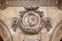Paris, France, March 31, 2017: Architectural details of Opera National de Paris: Haydn Facade sculpture. Grand Opera is famous neo-baroque building in Paris, France - UNESCO World Heritage Site