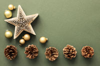 Christmas decoration background with pine cones and a star