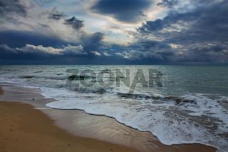 stormy sky over sea and sandy beach