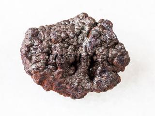 rough Goethite stone (brown iron) on white