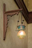 Vintage Arabic glass street lantern hanged on a wooden pole
