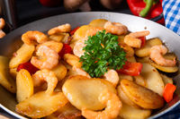 a delicious fried potato and shrimp pan