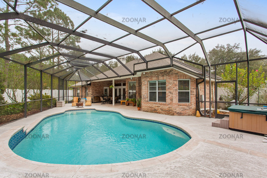American Home New Stylish Swimming Pool Exterior Luxury Up Scale Bright Sunny Warm Day Backyard Empty Nobody