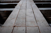 old wooden board floor  or plank construction in attic loft -
