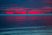 Colorful sunset over the sea. Dark dramatic sky