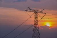 power transmission pylon in sunset
