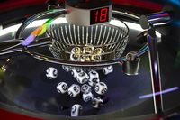 Black and white lottery balls in a rotating bingo machine. Number 18