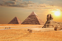 The Sphinx and the Pyramids at sunset in Giza