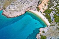 Island of Krk idyllic pebble beach with karst landscape aerial view, stone deserts of Stara Baska