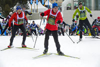 Cross country skiers at the Engadin Skimarathon on the climb, St. Moritz, Switzerland
