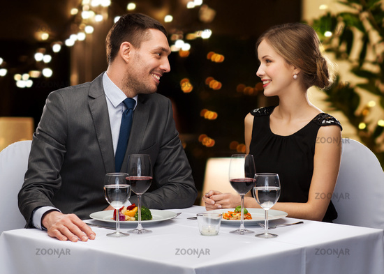 couple with food and red wine at restaurant