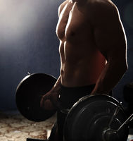 Man doing weightlifting workout in the gym
