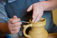 Professional male potter working in workshop, studio