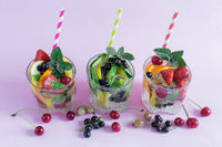 Homemade summer refreshing cocktail of fruits and berries.