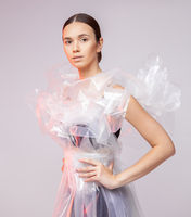 Portrait of a girl in polyethylene. Fashion portrait.
